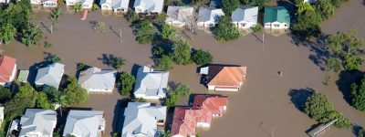 houses flooded representing flood insurance